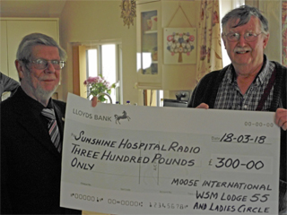 Alan Flower from Moose International, Weston-super-Mare Lodge 55 & Ladies Circle, presents cheque to Dave Lloyd from SHR.